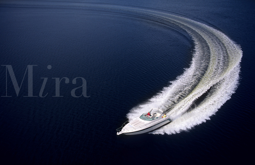 Speed boat glides through ocean water.