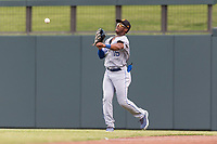 Surprise Saguaros right fielder Khalil Lee (15), of the Kansas City Royals organization, throws to second base during an Arizona Fall League game against the Salt River Rafters at Salt River Fields at Talking Stick on October 23, 2018 in Scottsdale, Arizona. Salt River defeated Surprise 7-5 . (Zachary Lucy/Four Seam Images)