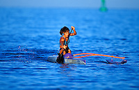Tiare getting a workout paddling her outrtigger canoe off the Kona coast on the Big Island of Hawaii