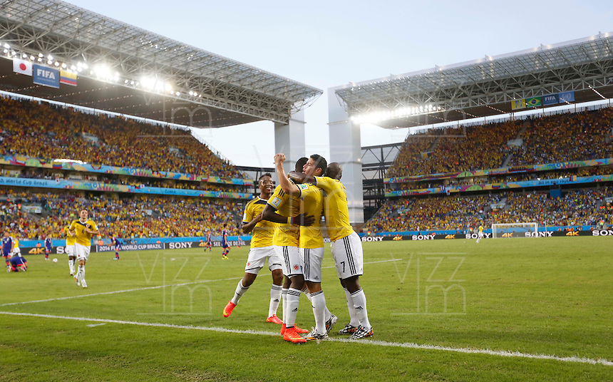 CUIABA - BRASIL -24-06-2014. Foto: Roberto Candia / Archivolatino<br /> James Rodriguez (#10), Pablo Armero (#7) y Jackson Martinez (#21) jugadores de Colombia (COL) celebran un gol anotado a Japón (JPN) durante partido del Grupo C de la Copa Mundial de la FIFA Brasil 2014 jugado en el estadio Arena Pantanal de Cuiaba./ ames Rodriguez (#10), Pablo Armero (#7) and Jackson Martinez (#21) players of Colombia (COL) celebrate a goal scored to Japan (JPN) during the match of the Group C of the 2014 FIFA World Cup Brazil played at Arena Pantanal stadium in Cuiaba. Photo: Roberto Candia / Archivolatino<br /> VizzorImage PROVIDES THE ACCESS TO THIS PHOTOGRAPH ONLY AS A PRESS AND EDITORIAL SERVICE IN COLOMBIA AND NOT IS THE OWNER OF COPYRIGHT; ANOTHER USE IS REPONSABILITY OF THE END USER. NO SALES, NO MERCHANDASING. ALL COPYRIGHT IS ARCHIVOLATINO