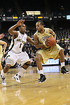 Georgia Tech Yellow Jackets guard Maurice Miller (3) tries to elude Wake Forest Demon Deacons guard Tony Chennault (1). Georgia Tech wins 80-54.