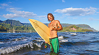 A local surfer gives the shaka sign in Hanalei Bay on Kaua'i.