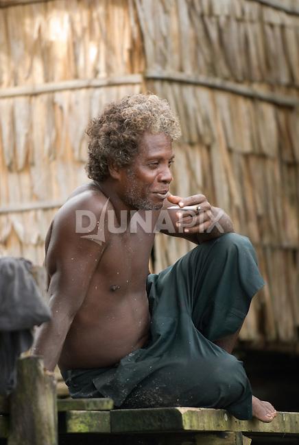 Portrait of a man smoking, Kia.