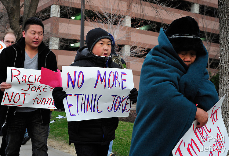 Members of Minnesota's Hmong community, joined by others, protest outside the headquarters of KDWB, a Minneapolis radio station that broadcast a song making fun of Hmongs. The song claimed that Hmong women are pregnant by the time they're 16, and that Hmongs live 30 people to a house, packed like sardines and sleeping on the floor. The song, broadcast on the morning Dave Ryan in the Morning Show, has provoked outrage among many in the Twin Cities, and caused several companies to pull their advertising from the popular show. Officials of the station, which is owned by Clear Channel Communications, have apologized, but Hmong leaders are demanding a greater response from the station.