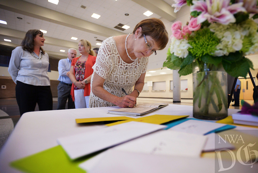 NWA Democrat-Gazette/BEN GOFF @NWABENGOFF<br /> Guests sign the guestbook for Dr. Janie Darr, superintendent of Rogers Public Schools, on Sunday June 12, 2016 during a retirement celebration for her at Rogers High School. Darr has served various roles in Rogers Public Schools over the past 46 years, including 17 years as superintendent.