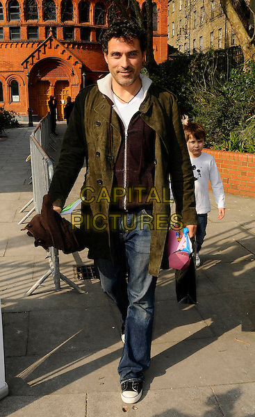 "RUFUS SEWELL .At the 2nd ""Mummy Rocks"" Fundraising event, The Tabemrche, powis Square, London, England, UK, March 21st 2009..full length green khaki coat jeans trainers converse .CAP/CAN.©Can Nguyen/Capital Pictures"