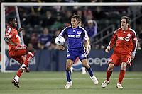Josh Wolff (16) battles against Rohan Ricketts (left) and Jim Brennan (11). Toronto FC defeated Kansas City Wizards 3-2 at Community America Ballpark, Kansas City, Kansas on March 21, 2009.