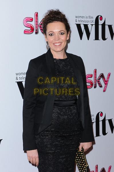 Olivia Colman.Women In Film & Television Awards 2012 held at the Hilton, London, England, UK, 7th December 2012..half length black lace dress jacket clutch bag gold studded studs .CAP/CJ.©Chris Joseph/Capital Pictures.