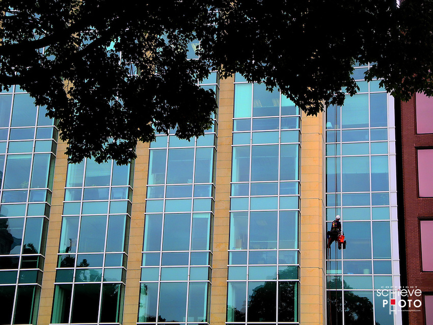 Window washer on a high rise in downtown Madison, Wisconsin.