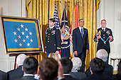 United States President Barack Obama and William Swenson, a former active duty Army Captain, listens as the citation is read prior to Swenson accepting the Medal of Honor for conspicuous gallantry in the East Room of the White House in Washington, D.C. on October 14, 2013.  Captain Swenson accepted the Medal of Honor for his courageous actions while serving as an Embedded Trainer and Mentor of the Afghan National Security Forces with Afghan Border Police Mentor Team, 1st Battalion, 32nd Infantry Regiment, 3rd Brigade Combat Team, 10th Mountain Division, during combat operations in Kunar Province, Afghanistan on September 8, 2009.<br /> Credit: Ron Sachs / CNP
