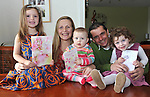 The O'Shea girls Georgia, Anna and Holly with parents Mike and Stella from Dromin, Killorglin, County Kerry who were born on January 2nd in different years reading some early birthday cards at home on Monday..Picture by Don MacMonagle.Story by majella O'Sullivan