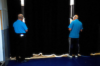 17 JUL 2010 - SHEFFIELD, GBR - Volunteers peer through gaps in curtains to watch a GB Cup wrestling match .(PHOTO (C) NIGEL FARROW)