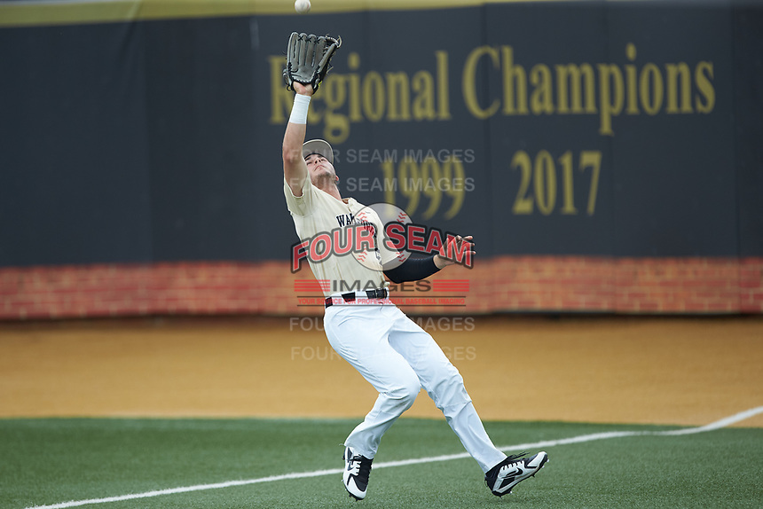 Wake Forest Demon Deacons right fielder Michael Ludowig (22) tracks a fly ball during the game against the Virginia Cavaliers at David F. Couch Ballpark on May 19, 2018 in  Winston-Salem, North Carolina. The Demon Deacons defeated the Cavaliers 18-12. (Brian Westerholt/Four Seam Images)
