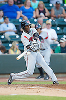 Yandy Diaz (9) of the Carolina Mudcats makes contact with the baseball during the game against the Winston-Salem Dash at BB&T Ballpark on June 6, 2014 in Winston-Salem, North Carolina.  The Mudcats defeated the Dash 3-1.  (Brian Westerholt/Four Seam Images)