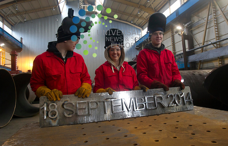 Apprentices Nicole Mitchell and Gavin Murphy and Kyle Doherty  finish the welding of the date for the Scotland Referendum that will be on the 18th of September 2014 at  Wesytway Park Engineering in Renfrew: The independence referendum's purdah period, which prevents government from announcing new legislation, will begin when Holyrood is still sitting. The plan will form part of the Scottish Independence Referendum Bill, which has cleared a key committee stage. Purdah will start on 21 August 2014, but Holyrood will not go into recess until 23 August. The people of Scotland will vote on their country's future on 18 September next year. They will be asked a straight yes/no question: &quot;Should Scotland be an independent country?&quot;<br />