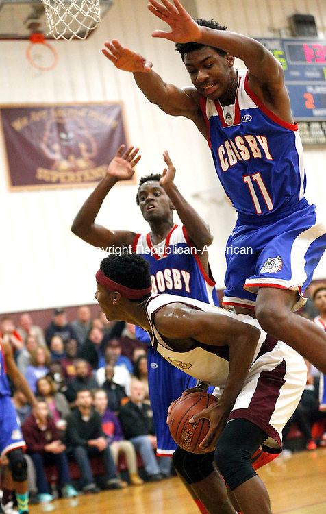 Waterbury, CT- 15 January 2016-011516CM09-  Sacred Heart's Charles Fisher looks to the hoop ahead of Crosby's Dan Jones (left) and Jeremiah Kendall during their NVL matchup in Waterbury on Friday.  Sacred Heart would go onto win, 96-61.  Christopher Massa Republican-American