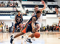 WASHINGTON, DC - NOVEMBER 16: Isaiah Burke #2 of Morgan State dribbles past Jamison Battle #10 of George Washington during a game between Morgan State University and George Washington University at The Smith Center on November 16, 2019 in Washington, DC.