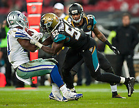 09.11.2014.  London, England.  NFL International Series. Jacksonville Jaguars versus Dallas Cowboys. Dallas Cowboys' Running Back Joseph Randle (#21) is tackled by Jaguars' J.T.Thomas (#52)