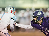 NWA Democrat-Gazette/CHARLIE KAIJO Fayetteville High School free safety Will Litzinger (31) reaches for Southside High School wide receiver Andre Rosa (1) during a playoff football game on Friday, November 10, 2017 at Fayetteville High School in Fayetteville.