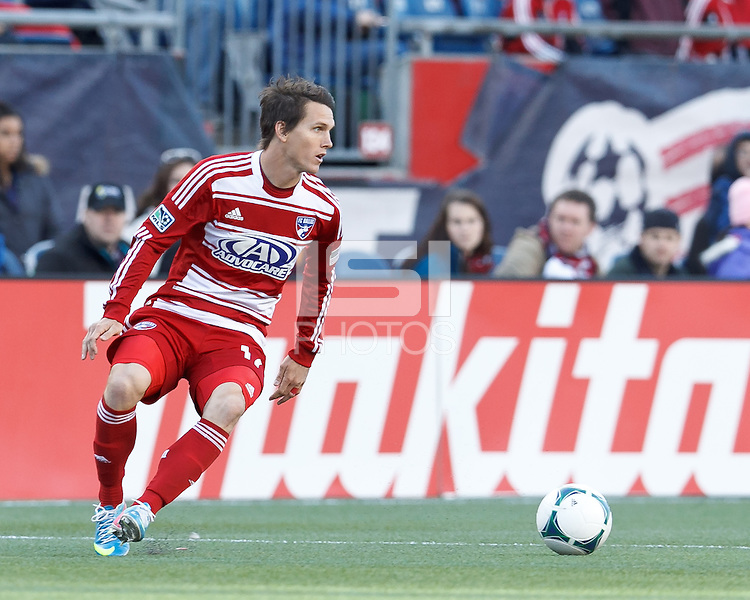 FC Dallas defender Zach Loyd (17) looks to pass..  In a Major League Soccer (MLS) match, FC Dallas (red) defeated the New England Revolution (blue), 1-0, at Gillette Stadium on March 30, 2013.
