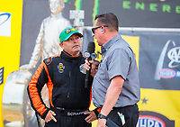 Sep 29, 2019; Madison, IL, USA; NHRA top fuel driver Mike Salinas (left) is interviewed by announcer Joe Castello during the Midwest Nationals at World Wide Technology Raceway. Mandatory Credit: Mark J. Rebilas-USA TODAY Sports