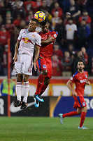 Harrison, NJ - Thursday March 01, 2018: Tyler Adams, Luis Ovalle. The New York Red Bulls defeated C.D. Olimpia 2-0 (3-1 on aggregate) during a 2018 CONCACAF Champions League Round of 16 match at Red Bull Arena.