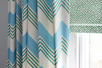 Detail of the green, blue and white zig-zag pattern on a curtain
