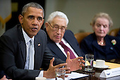 United States President Barack Obama, left, speaks while meeting with current and former diplomatic and national security officials including Henry Kissinger, former U.S. Secretary of State, center, and Madeleine Albright, former U.S. Secretary of State and founder of Albright Stonebridge Group LLC, to discuss the Trans-Pacific Partnership (TPP) in the Roosevelt Room of the White House in Washington, D.C., U.S., on Friday, November 13, 2015. Obama, hoping to kick off a new phase of selling the TPP at home while enhancing its prospects overseas, has enlisted some of the nation's top national security leaders to give testimonials. <br /> Credit: Andrew Harrer / Pool via CNP