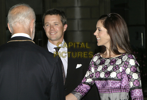 """CROWN PRINCE FREDERIK & CROWN PRINCESS MARY .Arrive to open a new exhibition with works frim the NY Carlsberg glyptotek, Copenhagen called """"Ancient Art to Post-Impressionism"""" at the Royal Academy of Arts, London, September 14th 2004..half length purple grey black geometric print flower  patterned dress Donaldson Danish royalty.Ref: AH.www.capitalpictures.com.sales@capitalpictures.com.©Capital Pictures."""