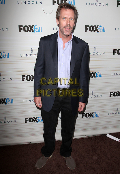 HUGH LAURIE.FOX's 2010 Fall Eco-Casino Party held at BOA Steak House, West Hollywood, CA, USA..September 13th, 2010.full length black trousers blue navy suit jacket shirt brown shoes mouth open.CAP/ADM/KB.©Kevan Brooks/AdMedia/Capital Pictures.