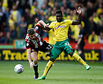 Ched Evans of Sheffield Utd tackles Alexander Tettey of Norwich City during the Championship match at Bramall Lane Stadium, Sheffield. Picture date 16th September 2017. Picture credit should read: Simon Bellis/Sportimage