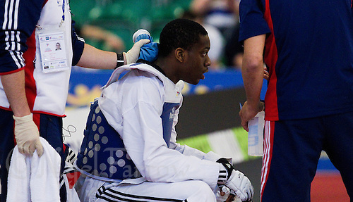 04 MAY 2012 - MANCHESTER, GBR - Lutalo Muhammad (GBR) of Great Britain recovers during a break between rounds in his men's -87kg category second round contest against Jon Garcia Aguado of Spain at the 2012 European Taekwondo Championships at Sportcity in Manchester, Great Britain (PHOTO (C) 2012 NIGEL FARROW)