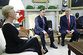 Polish First Lady Agata Kornhauser-Duda (L) withUS President Donald J. Trump (R) and Polish President Andrzej Duda (C) during a meeting in the Oval Office of the White House in Washington, DC, USA, 12 June 2019. Later in the day President Trump and President Duda will participate in a signing ceremony to increase military to military cooperation including the purchase of F-35 fighter jets and an increased US troop presence in Poland. <br /> Credit: Shawn Thew / Pool via CNP