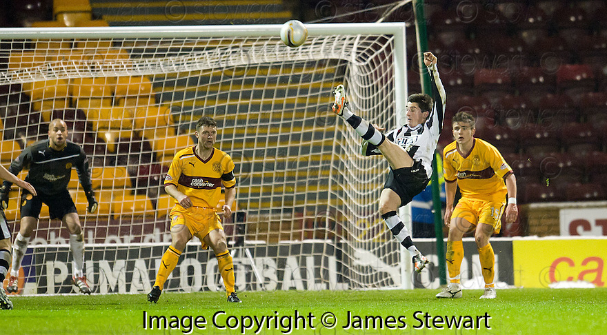 ST MIRREN'S KENNY MCLEAN'S SPECTAULAR SHOT IS TIPPED OVER THE BAR..17/12/2011 sct_jsp011_motherwell_v_st_mirren     .Copyright  Pic : James Stewart.James Stewart Photography 19 Carronlea Drive, Falkirk. FK2 8DN      Vat Reg No. 607 6932 25.Telephone      : +44 (0)1324 570291 .Mobile              : +44 (0)7721 416997.E-mail  :  jim@jspa.co.uk.If you require further information then contact Jim Stewart on any of the numbers above.........