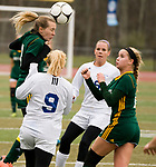 MIDDLETOWN, CT-111817JS26- Holy Cross' Erin Goggin (3) heads the ball in front of teammate Kiley Harnish (9), Old Lyme's Jenny Ritchie (9) and Ellery Zrenda (6), during their Class S state final game Saturday at Middletown High School.<br /> Jim Shannon Republican-American