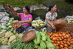 Women sell produce in the Tahan Market in Kalay, a town in Myanmar. This market is located in Tahan, the largely ethnic Chin section of the town.