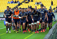 The Highlanders return to the changing rooms after warmup for the Super Rugby Aotearoa match between the Hurricanes and Highlanders at Sky Stadium in Wellington, New Zealand on Sunday, 12 July 2020. Photo: Dave Lintott / lintottphoto.co.nz