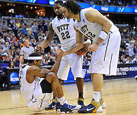 Aron Nwankwo of the Panthers gets helping hand from his teammates.  Butler upset no.1 seed Pittsburgh 71-70 during the 3rd round of the NCAA Tournament at the Verizon Center in Washington, D.C on Saturday, March 19, 2011. Alan P. Santos/DC Sports Box