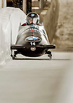 8 January 2016: Chris Spring, piloting his 2-man bobsled for Canada, enters the Chicane straightaway on his first run, ending the day with a combined 2-run time of 1:51.58 and earning a 12th place finish at the BMW IBSF World Cup Championships at the Olympic Sports Track in Lake Placid, New York, USA. Mandatory Credit: Ed Wolfstein Photo *** RAW (NEF) Image File Available ***