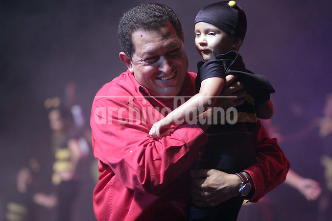 Venezuelan President Hugo Chavez holds a boy during a rally of the PSUV, the socialist united party that he sponsors as ruling party