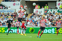 Saturday 20 September 2014 <br /> Pictured: Wilfried Bony of Swansea (2nd L) clashes in mid air against a Southampton player<br /> Re: Barclays Premier League Swansea City v Southampton  at the Liberty Stadium, Swansea, Wales,UK