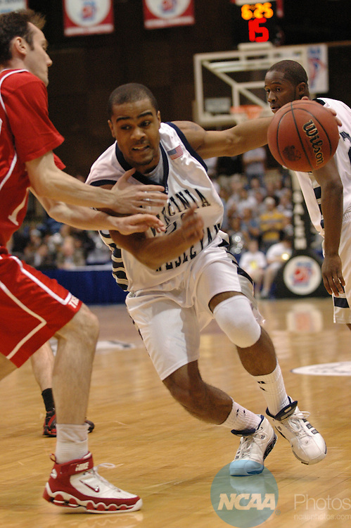18 MAR  2006 : Marques Fitch (20), of Virginia Wesleyan drives to the basket during the Division III Men's Basketball Championship held at the Salem Civic Center in Salem, VA.  Virginia Wesleyan defeated Wittenberg (59-56) for the national title.  Andres Alonso/NCAA Photos