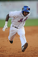 Kingsport Mets second baseman Yucary De la Cruz #1 runs to third during  a  game  against the Pulaski Mariners at Hunter Wright Stadium on August 9, 2011 in Kingsport, Tennessee. Kingsport won the game 2-1.   (Tony Farlow/Four Seam Images)