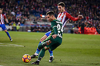Atletico de Madrid's Sime Vrsaljko  and Real Betis's Ruben Castro during La Liga match between Atletico de Madrid and Real Betis at Vicente Calderon Stadium in Madrid, Spain. January 14, 2017. (ALTERPHOTOS/BorjaB.Hojas) /NORTEPHOTO.COM