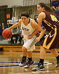 SIOUX FALLS, SD - JANUARY 30:  Alison Klostergaard #52 from the University of Sioux Falls tries to drive against Taylor Meyer #42 from Minnesota Duluth Friday night at the Stewart Center. (Photo by Dave Eggen/Inertia)