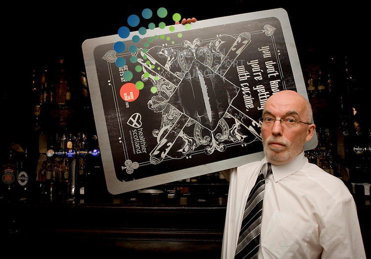 Stephen McBride Chairman of the Glasgow west end pub watch, and manager of Oran Mor Glasgow is seen with the cocaine know the score posters . Picture Johnny Mclauchlan/Universal news and Sport (Scotland)19/11/09.