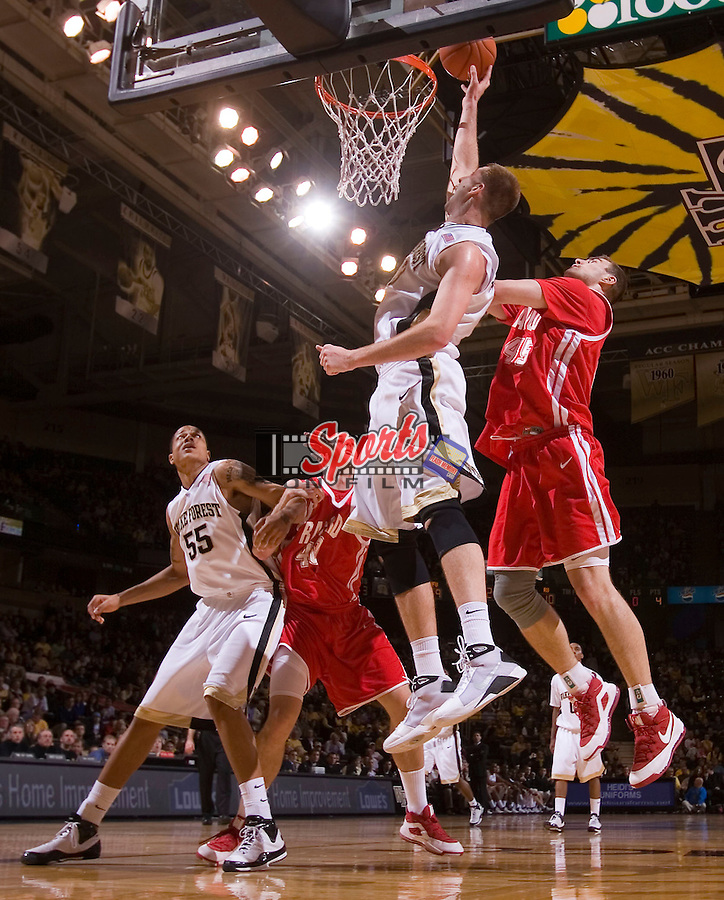 Chas McFarland #13 of the Wake Forest Demon Deacons scores in front of Artsiom Parakhouski #45 of the Radford Highlanders during first half action at the LJVM Coliseum December 30, 2008 in Winston-Salem, NC. (Photo by Brian Westerholt / Sports On Film)
