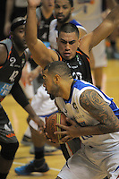 Anamata Haku marks Benny Anthony Jr during the national basketball league final between Wellington Saints and Bay Hawks at TSB Bank Arena, Wellington, New Zealand on Saturday, 5 July 2014. Photo: Dave Lintott / lintottphoto.co.nz