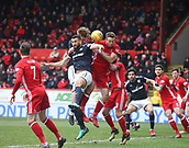 17th March 2018, Pittodrie Stadium, Aberdeen, Scotland; Scottish Premier League football, Aberdeen versus Dundee; Steven Caulker and Mark O'Hara of Dundee compete in the air with Andrew Considine of Aberdeen