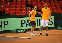 09-09-13,Netherlands, Groningen,  Martini Plaza, Tennis, DavisCup Netherlands-Austria, DavisCup,   Practice, Captain Jan Siemerink sweeps the clay court while Thiemo de Bakker (NED) looks on<br /> Photo: Henk Koster